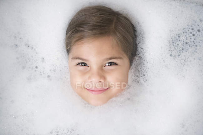 Close-up of Girls head in a bubble bath — Stock Photo