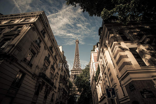 Low angle view of Eiffel Tower seen from street, France, Paris — Stock Photo