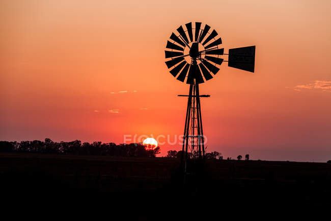 Silhouette of a Windmill at sunrise, Klerksdorp, South Africa — Stock Photo