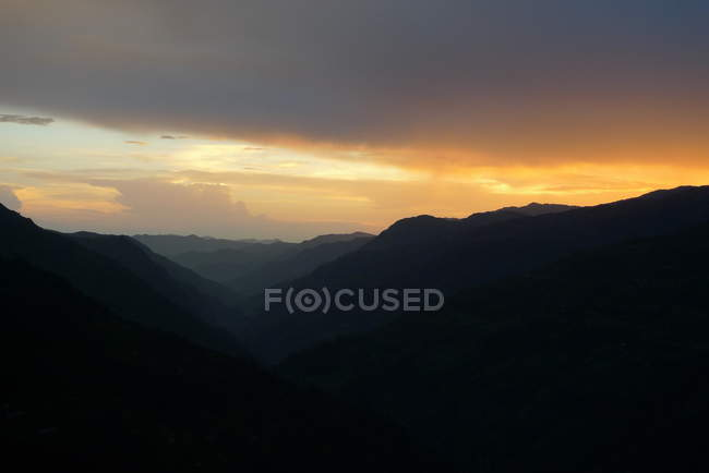 Scenic view of beautiful sunset behind hills — Stock Photo