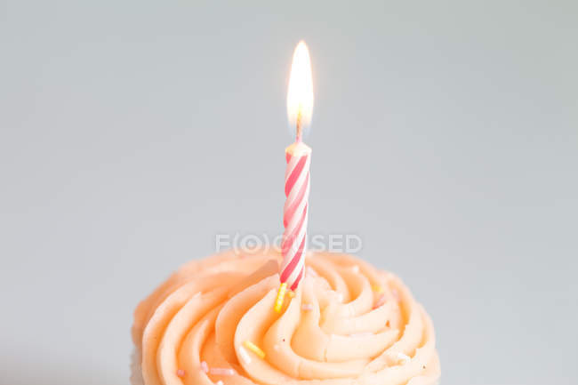 Cupcake with lighting candle On White Background — Stock Photo