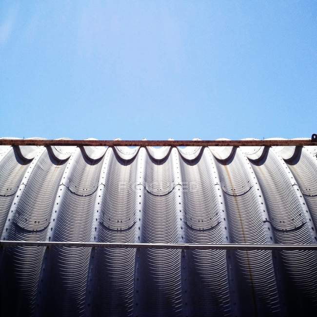 Closeup view of Industrial shed roof under blue sky — Stock Photo