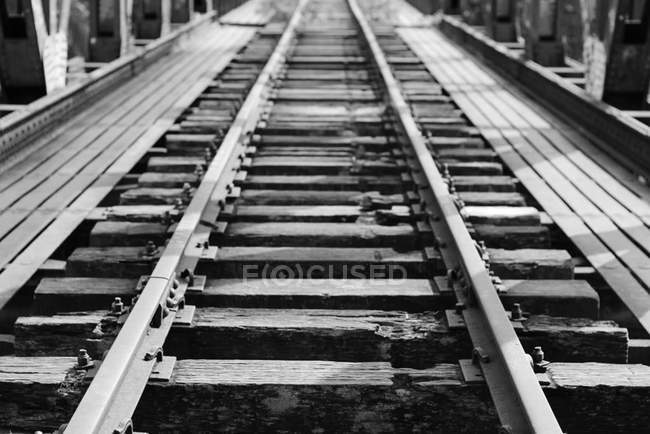 Elevated view of abandoned railroad track in monochrome — Stock Photo
