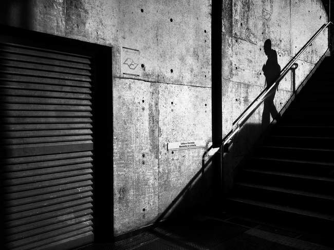 Monochrome image, shadow of person on stairs — Stock Photo