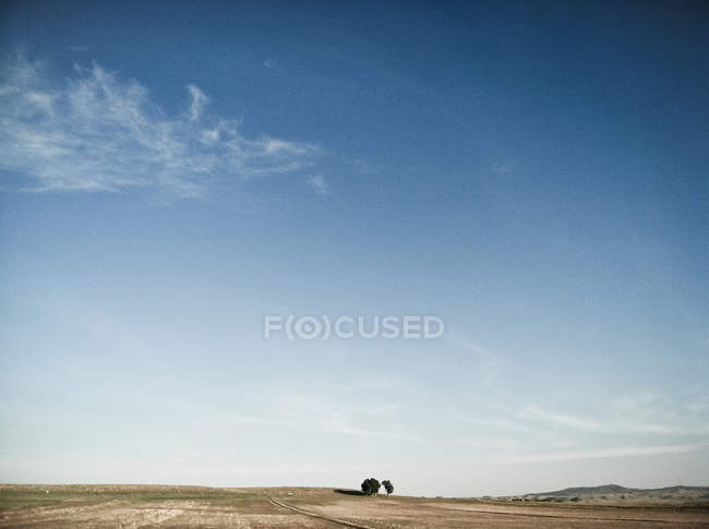 Scenic view of isolated landscape under blue sky — Stock Photo