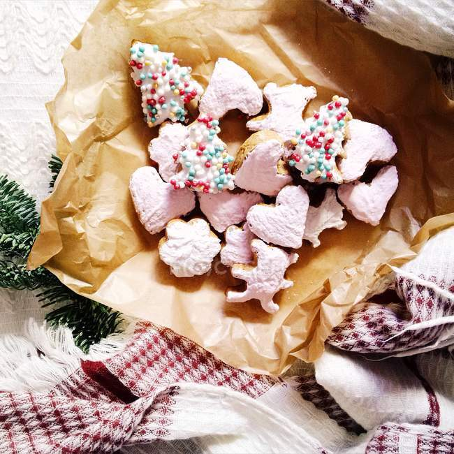 Homemade colorful gingerbread over cooking paper — Stock Photo