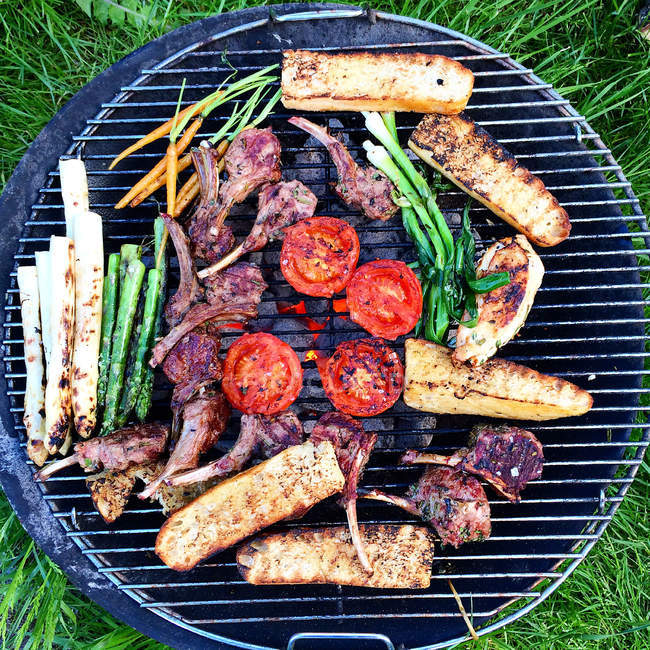 Barbecue with meat, vegetables and bread, top view — Stock Photo