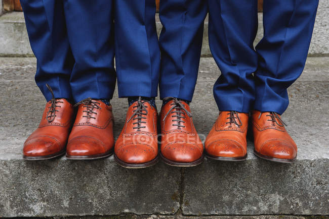 Partial view of Three men wearing brogues — Stock Photo