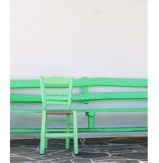 Scenic view of green chair by white wall — Stock Photo