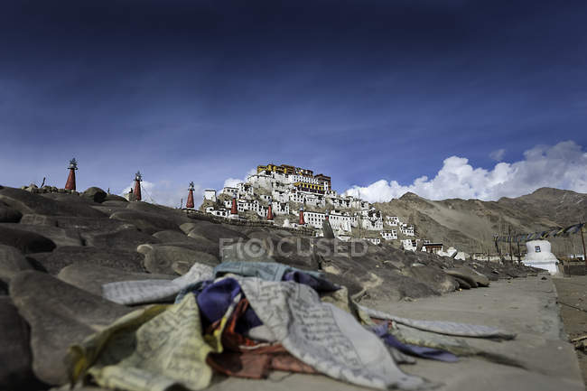 Scenic view of prayer flags and Thikshey Monastery, Leh, Jammu and Kashmir, India — Stock Photo