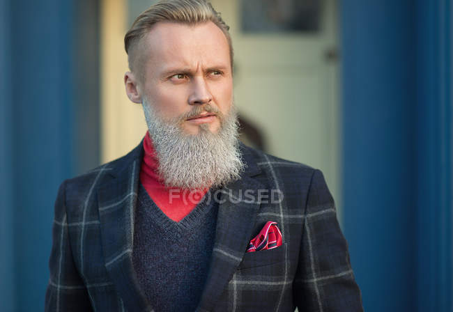 Portrait of funky hipster man looking sideways — Stock Photo