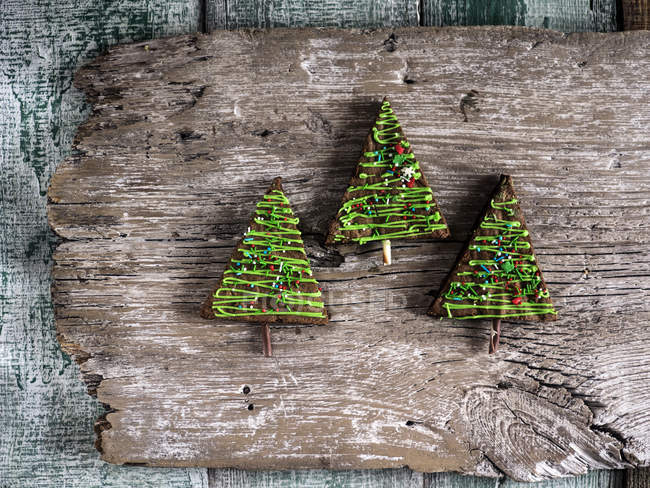 Christmas Tree Top View.Christmas Tree Shaped Cakes On Wooden Plank Top View