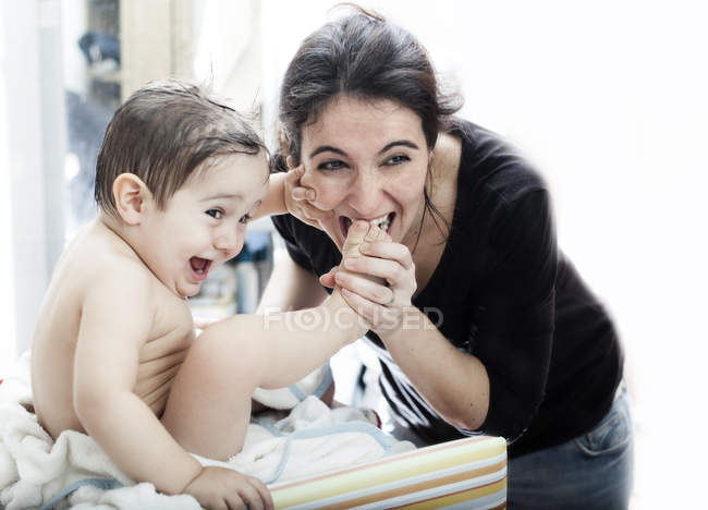 Adorable little boy playing with happy mother — Stock Photo