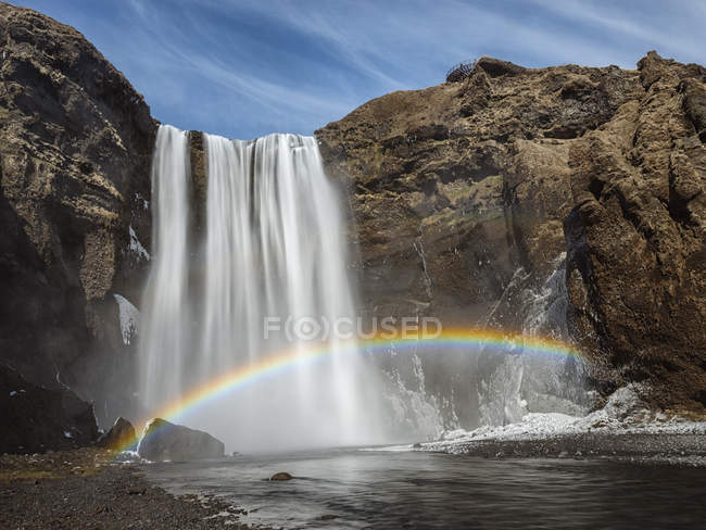 Scenic view of rainbow over Skogafoss waterfall, iceland — Stock Photo