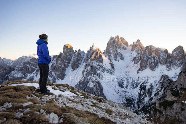 Woman standing in Dolomite Mountains and looking at view, South Tyrol, Italy — Stock Photo