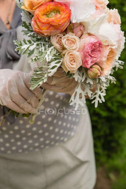 Cropped image of Woman holding bouquet of flowers — Stock Photo
