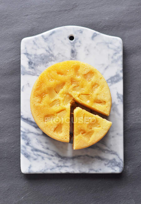 Pineapple cake on marble chopping board, top view — Stock Photo