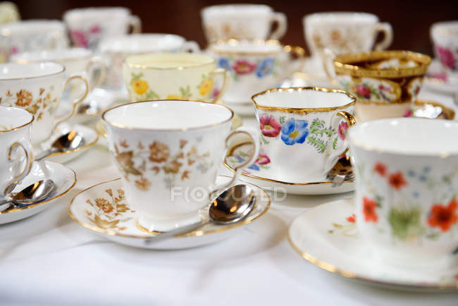 Floral porcelain teacups on a table — Stock Photo