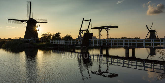 Traditional windmills at sunset, Kinderdisk, Netherlands — Stock Photo