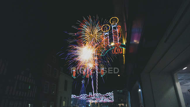 Fireworks and Christmas lights at night, Stratford-upon-Avon, England, UK — Stock Photo