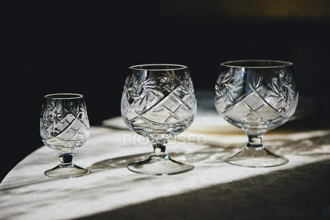 Closeup view of three crystal glasses — Stock Photo