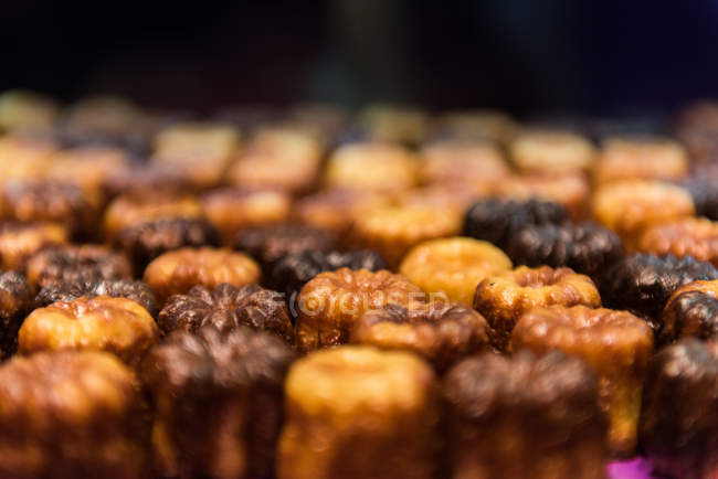 Closeup view of tasty canele cakes placed in rows — Stock Photo