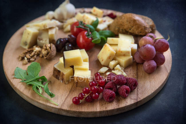Selection of Italian cheese on chopping board — Stock Photo