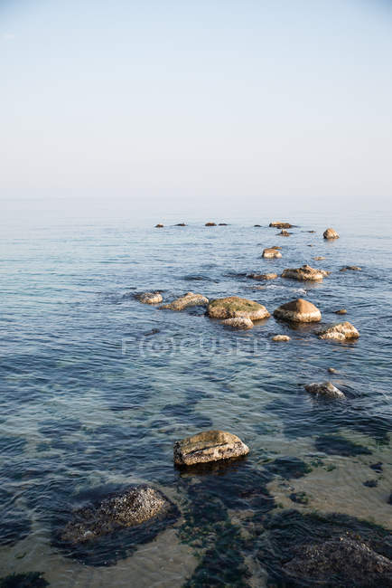 Scenic view of rocky coastline, vertical image — Stock Photo