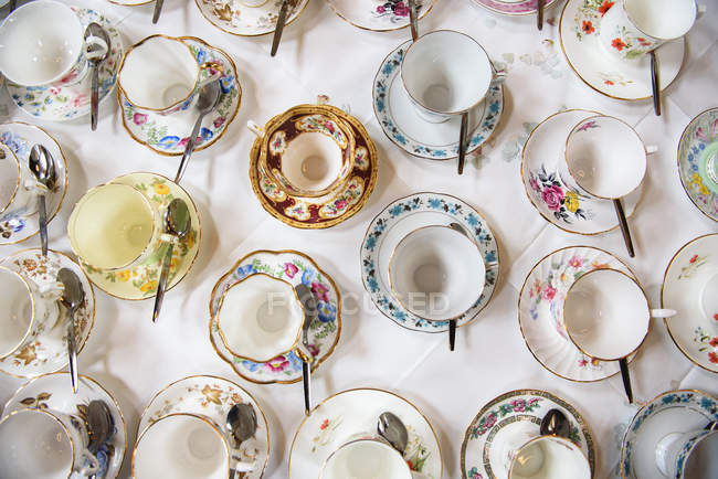 Various Provence vintage cups and saucers and spoons — Stock Photo
