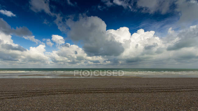 Scenic view of empty beach under dramatic clouds, Dieppe, Normandy, France — Stock Photo