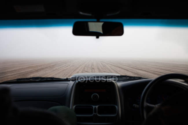 Inside view of car riding at foggy road in Namibia — Stock Photo