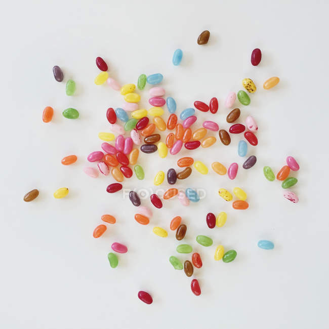 Multi-colored jelly beans on a white table — Stock Photo