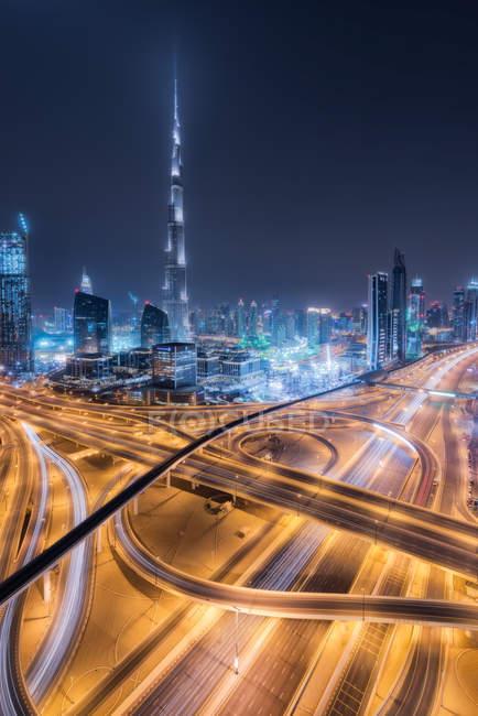 Scenic view of dubai skyline at night, UAE — Stock Photo