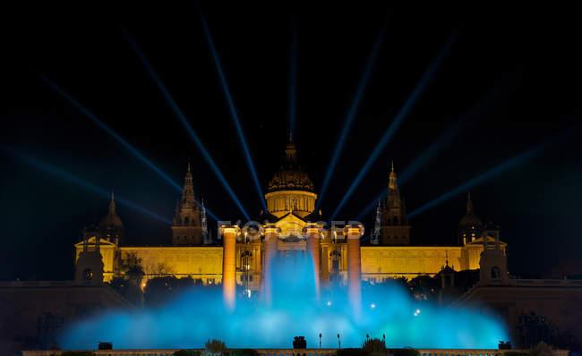 Spain, Catalonia, Barcelona, Night view of Magic Fountain against illuminated Plaza Espana — Stock Photo