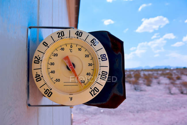 Thermometer on side of a house, Arizona, America, USA — Stock Photo