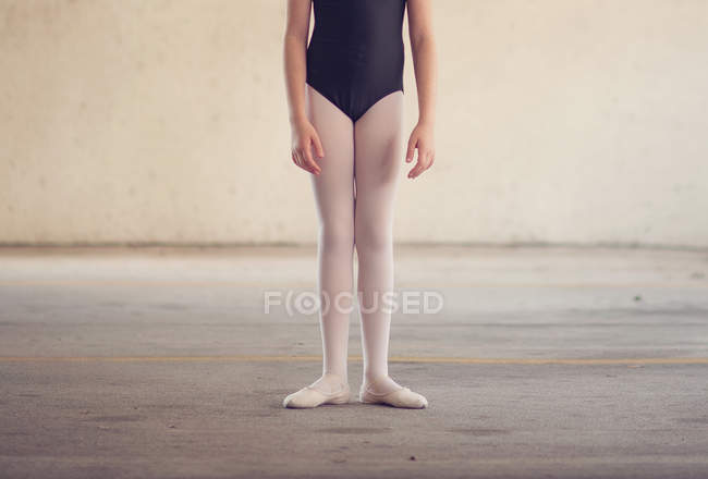 Ballet dancer Girl standing in first position — Stock Photo