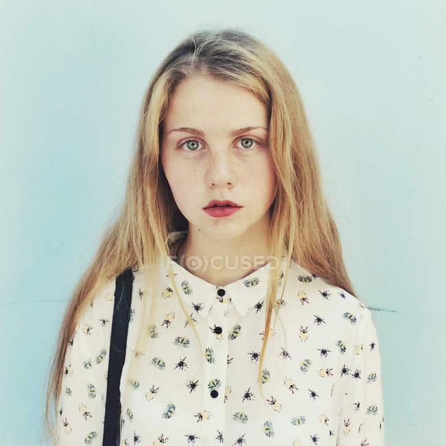 Portrait of blond teenage girl wearing patterned shirt — Stock Photo
