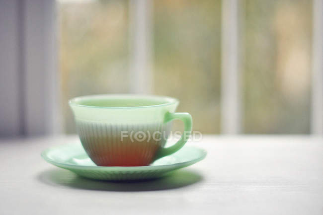 Closeup view of cup of tea against blurred background — Stock Photo