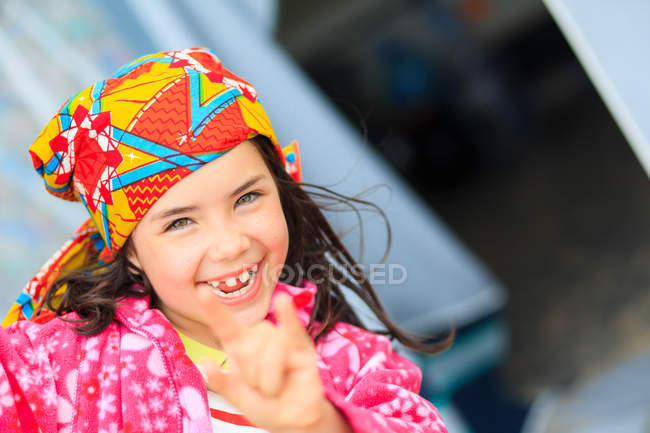 Smiling girl making cool hand gesture — Stock Photo