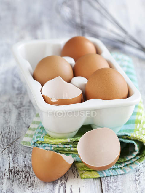 Brown eggs in plastic container — Stock Photo