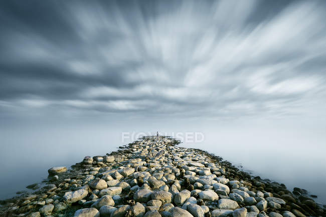 Conceptual Rocky road to infinity in nature — Stock Photo