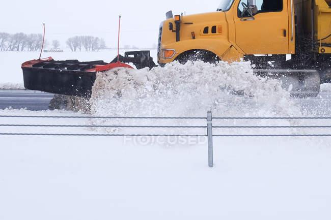 Snowplough plowing road, Wyoming, America, USA — Stock Photo