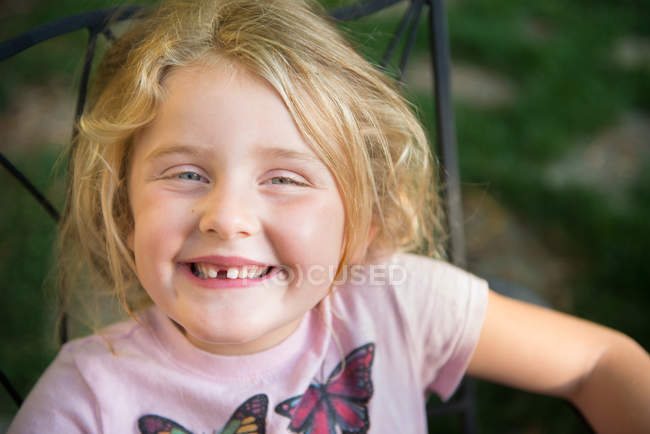 Portrait of blond little girl with toothy smile — Stock Photo