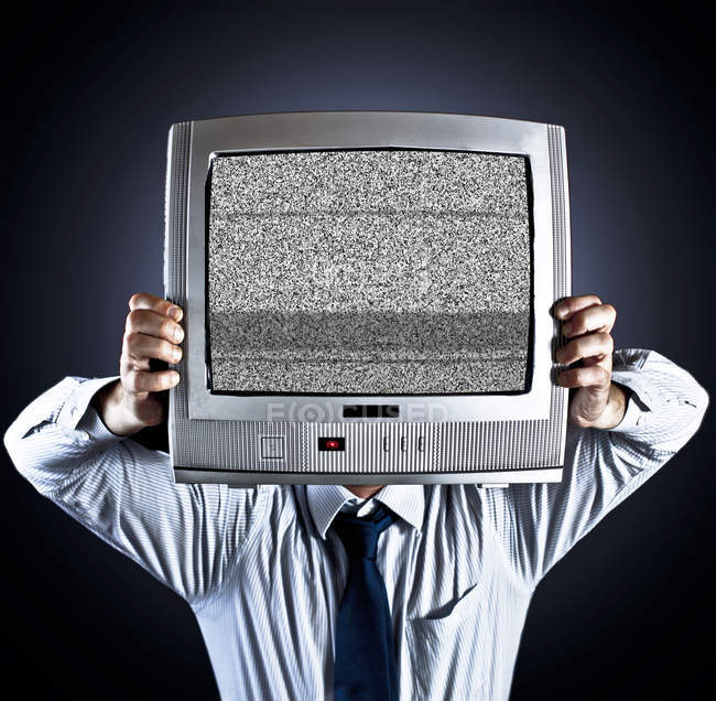 Man holding old fashioned television in front of face — Stock Photo