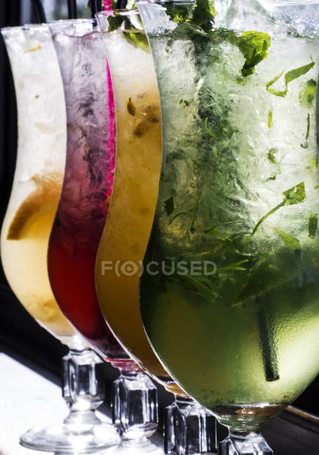 Close-up of four glasses of fruit lemonade — Stock Photo