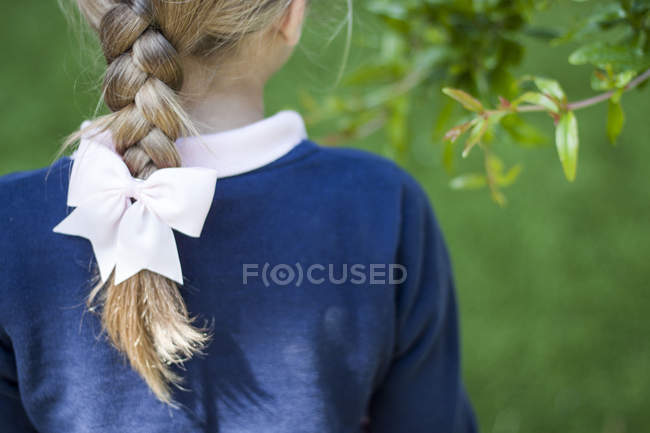 Close-up of blond girl with a braid — Stock Photo