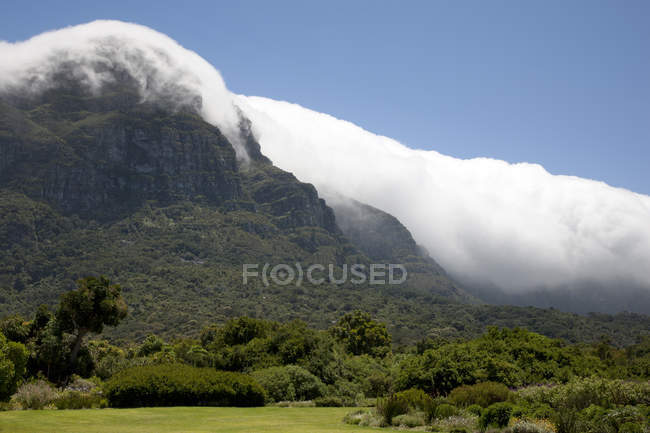 Scenic view of beautiful rural mountain landscape with fog — Stock Photo