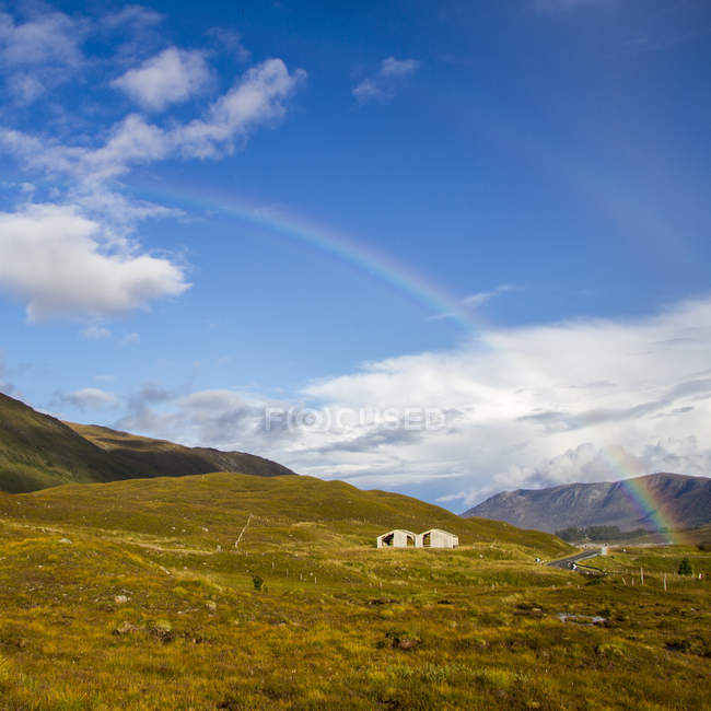 Scenic view of double rainbow in mountains, Scotland, UK — Stock Photo