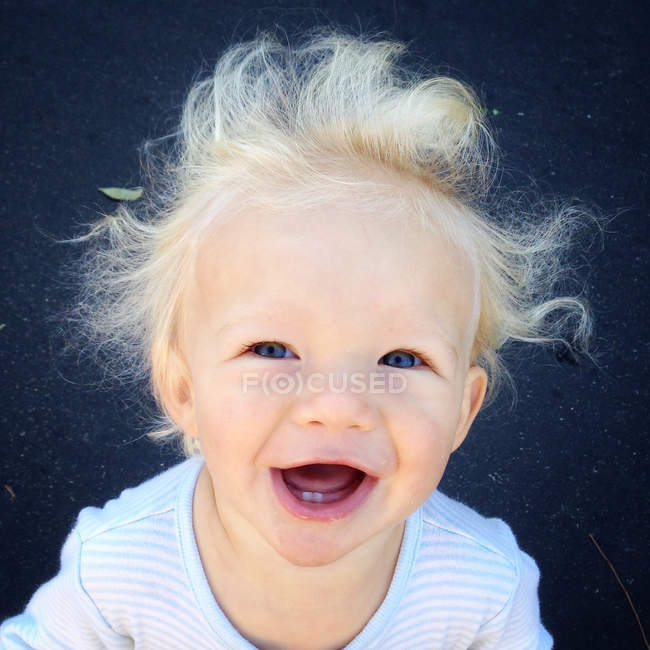 Portrait of toddler with flyaway hair — Stock Photo