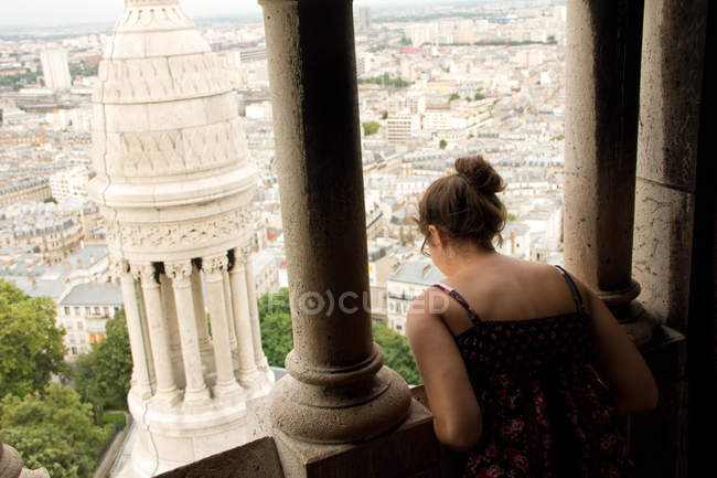 Back view of Woman looking out over city view — Stock Photo